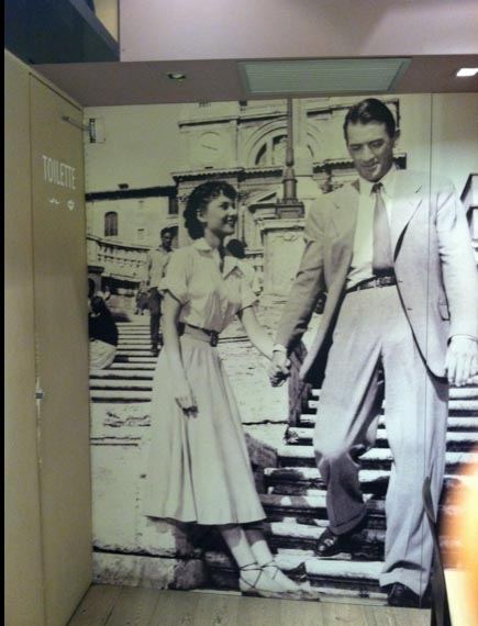 A life-size image of Audrey Hepburn and Gregory Peck from Roman Holiday, near the Spanish Steps