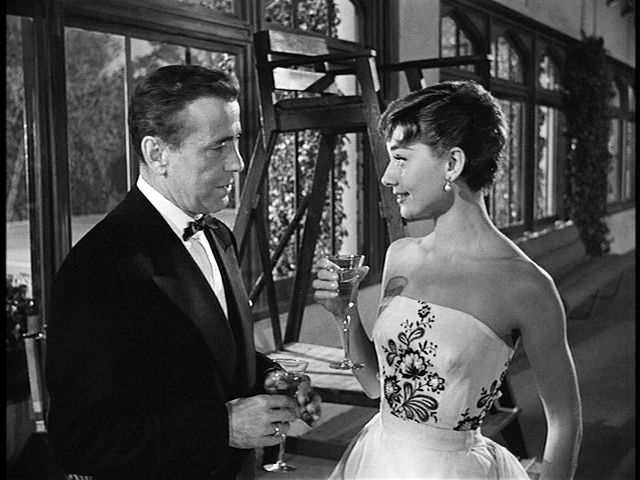 Humphrey Bogart and Audrey Hepburn in the film Sabrina