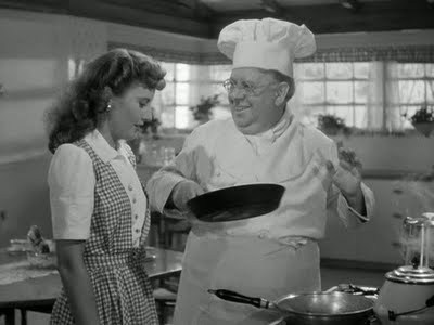S. Z. Sakall and Barbara Stanwyck in Christmas in Connecticut