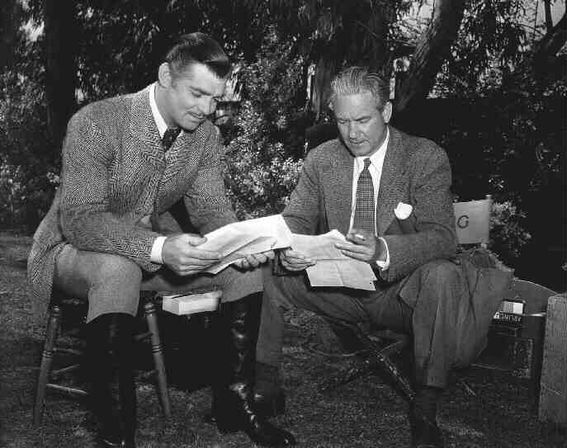 Clark Gable and Victor Fleming reading script notes for Gone with the Wind