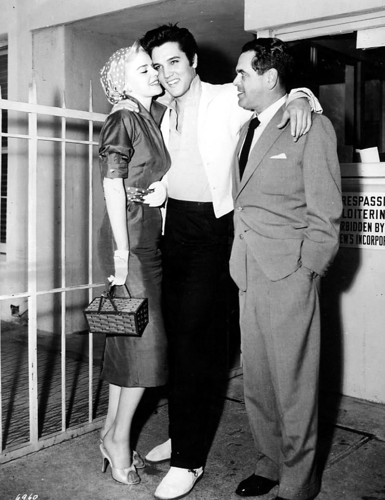 Elvis Presley,  Barbara Lang and Producer Pandro S. Berman on the set of Jailhouse Rock