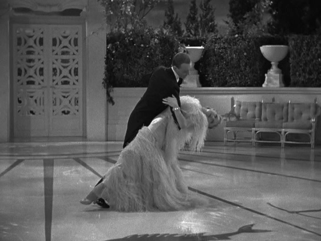 "Fred Astaire and Ginger Rogers dancing to Irving Berlin's ""Cheek to Cheek"" in Top Hat (Pandro S. Berman producer, Mark Sandrick director, 1935)"