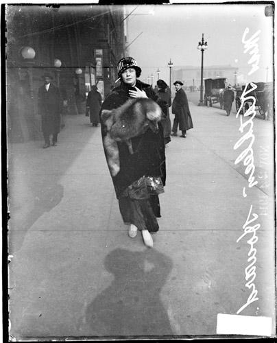Miss Kathleen Howard standing on South Michigan Avenue, between Congress and Van Buren