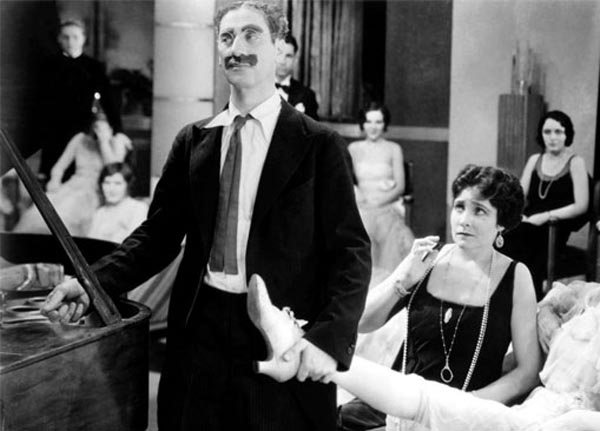 Groucho Marx as Captain Spaulding and Margaret Dumont as Mrs. Rittenhouse in Animal Crackers