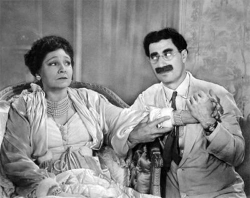 Groucho Marx as Attorney J. Cheever Loophole and Margaret Dumont as Mrs. Suzanna Dukesbury in At the Circus