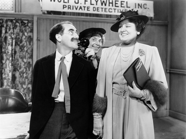 Margaret Dumont as Martha Phelps and Groucho Marx as Wolf J. Flywheel in The Big Store
