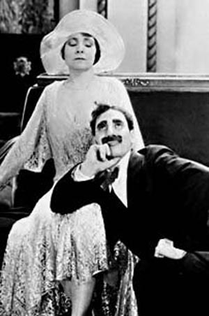 Groucho Marx as Hammer and Margaret Dumont as Mrs. Potter in The Cocoanuts
