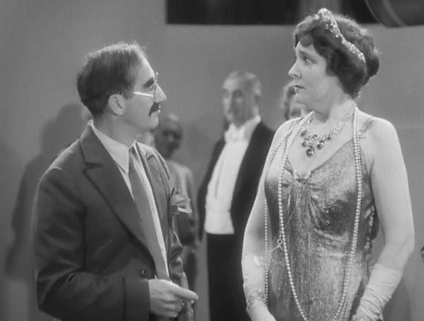 Groucho Marx as Rufus T. Firefly and Margaret Dumont as Mrs. Teasdale in Duck Soup