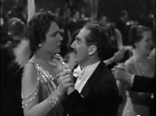 Groucho Marx as Dr. Hugo Hackenbush and Margaret Dumont as Mrs. Upjohn in A Day at the Races