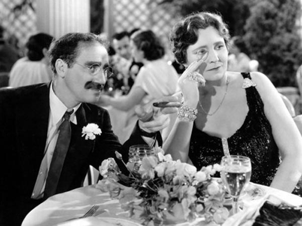 Groucho Marx as Otis B. Driftwood and Margaret Dumont as Mrs. Claypool in A Night at the Opera