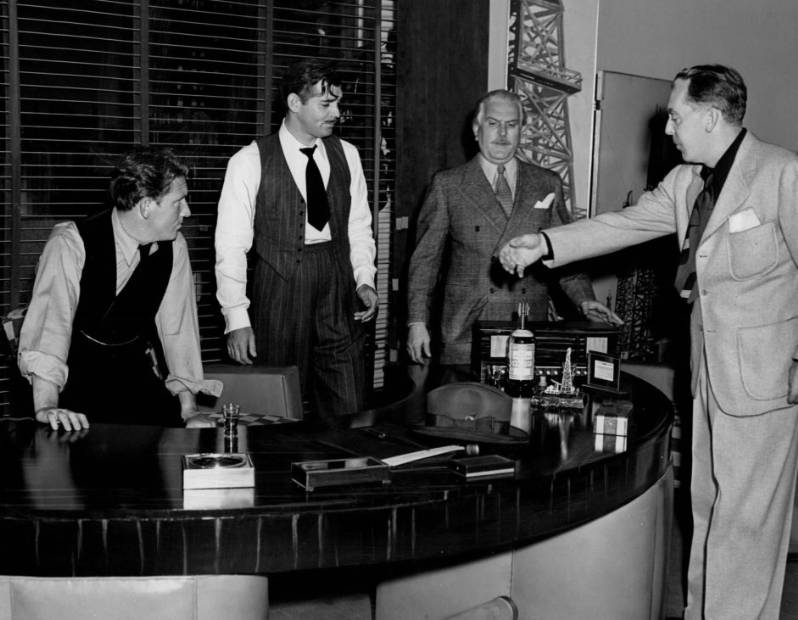 Spencer Tracy, Clark Gable, Frank Morgan and director Jack Conway rehearsing a scene from Boom Town