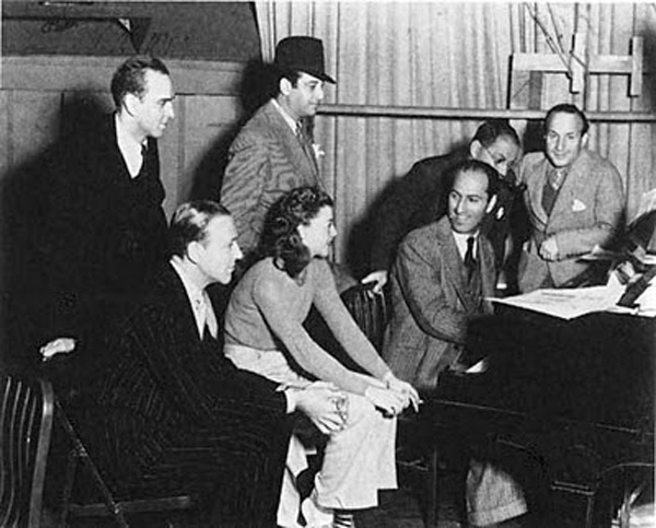 Choreographer Hermes Pan, Director Mark Sandrich, Ira Gershwin, musical director Nat Shilkret, Fred Astaire, Ginger Rogers, George Gershwin at the piano Production Still from Shall We Dance