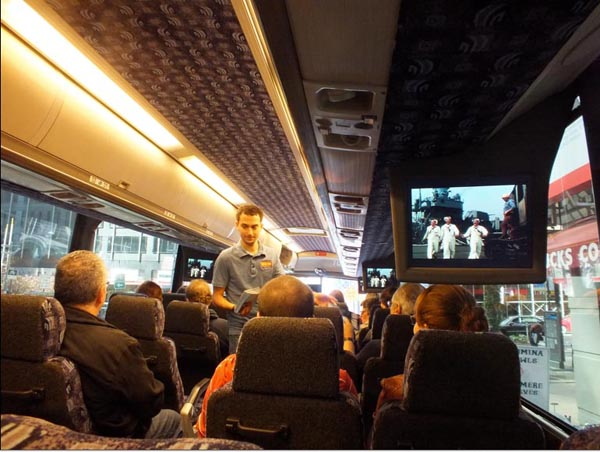 Turner Classic Movies TCM On Location NYC Tour inside bus with On The Town video clip playing