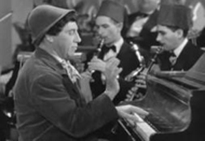 Chico Marx playing piano, A Night in Casablanca