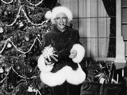 Bing Crosby dressed as Santa for Christmas