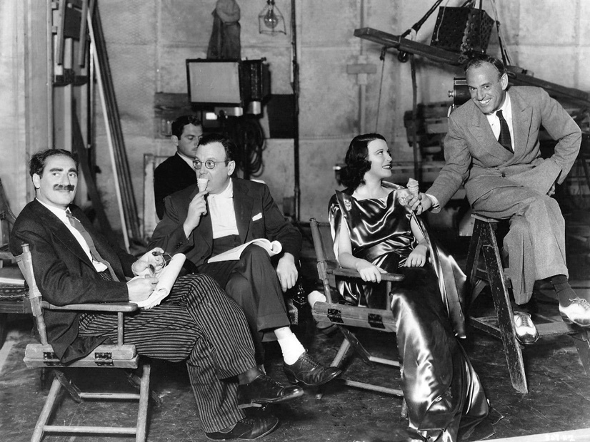 Groucho Marx, writer Al Boasberg, Kitty Carlisle and Sam Wood on the set of A Night at the Opera