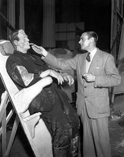 James Whale offering a light to Boris Karloff  on the set of Frankenstein