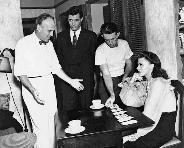 Sam Wood, James Craig, a crew member, and Ginger Rogers on the set of Kitty Foyle (1940).