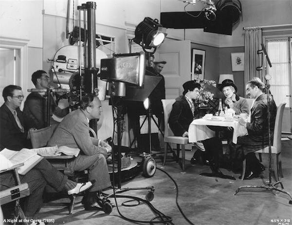 Sam Wood directing The Marx Brothers on the set of A Night at the Opera