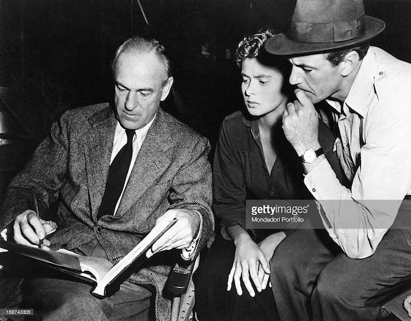 Sam Wood talking to Ingrid Bergman and Cary Cooper on the set of For Whom the Bell Tolls