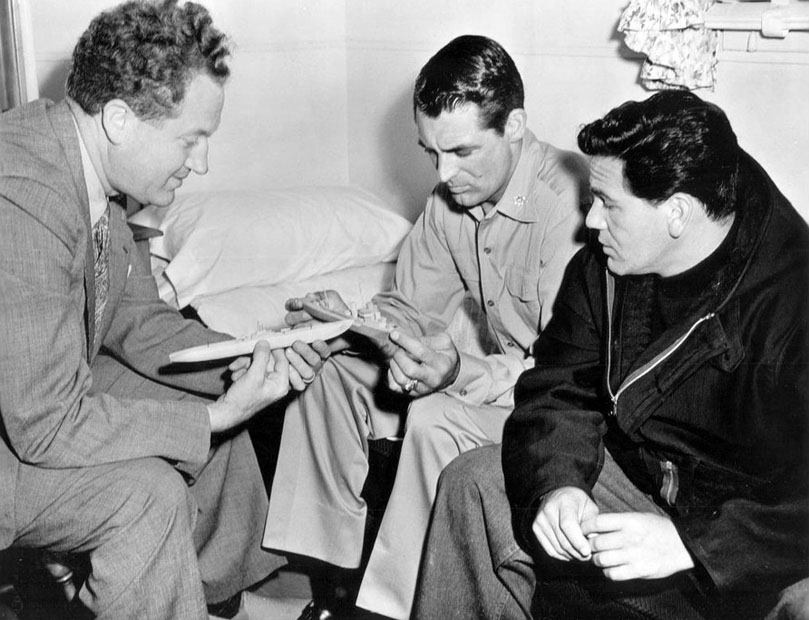 Director Delmer Daves, Cary Grant and John Garfield on the set of Destination Tokyo, behind the scenes