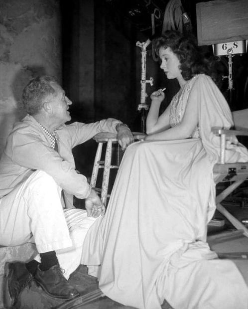 Director Delmer Daves talks with Susan Hayward between takes of Demetrius and the Gladiators