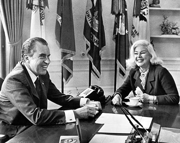 Sep. 19, 1971: President Richard Nixon relaxes from official duties to have a chat and cup of coffee with actress Ginger Rogers in his executive office at White House. Credit: Associated Press
