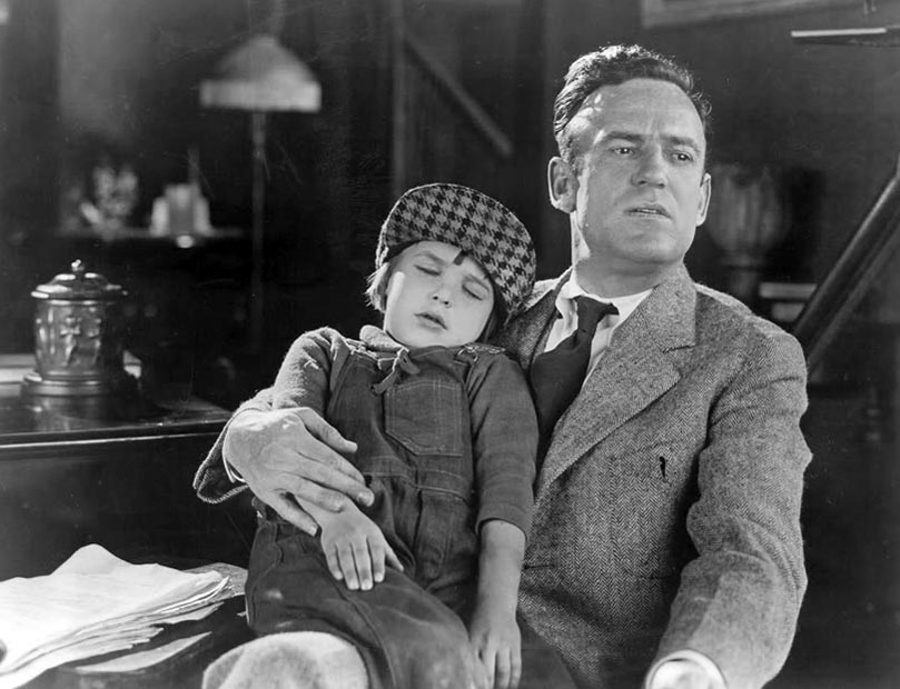Little Jackie Coogan and Sam Wood on the set of Peck's Bad Boy