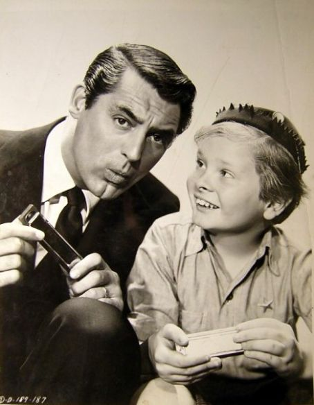 Child actor Ted Donaldson with Cary Grant in publicity still for Once Upon a Time 1944