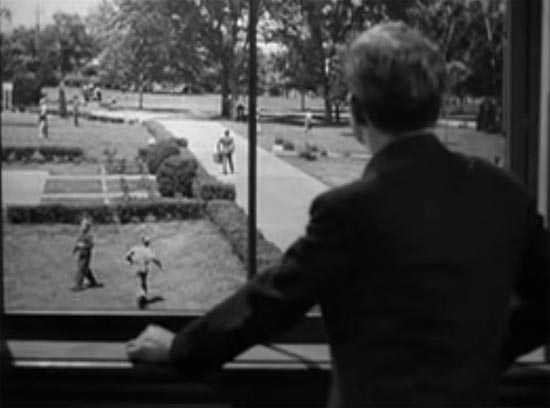 Father Flanagan (Spencer Tracy) watches as Whitey (Mickey Rooney) tries to leave Boys Town