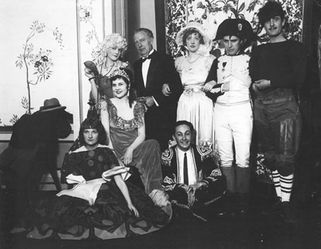 Marion Davis Halloween Party, Charlie Chaplin as Napoleon, Marion  on Charlie's right, Lita Grey (Chaplin's wife) in the middle row as Josephine de Beauharnais