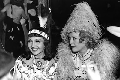 claudette colbert and marion davies, costume party