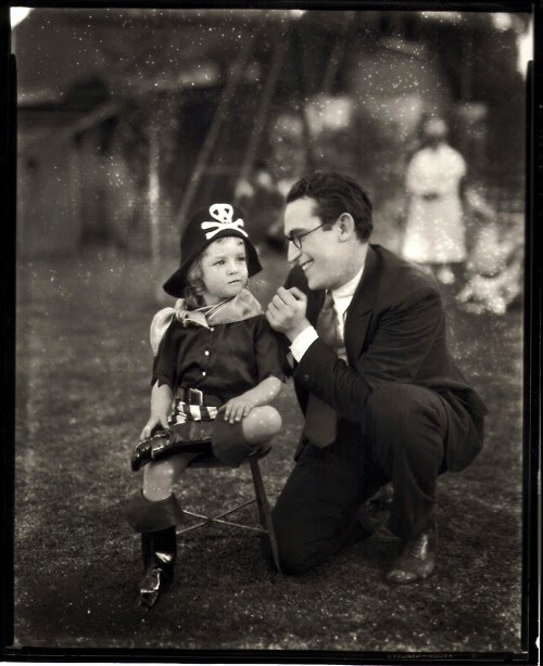Harold Lloyd and daughter Gloria celebrating Halloween, 1927