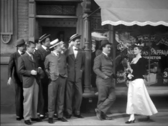 The Strawberry Blonde, Rita Hayworth walks past barber shop