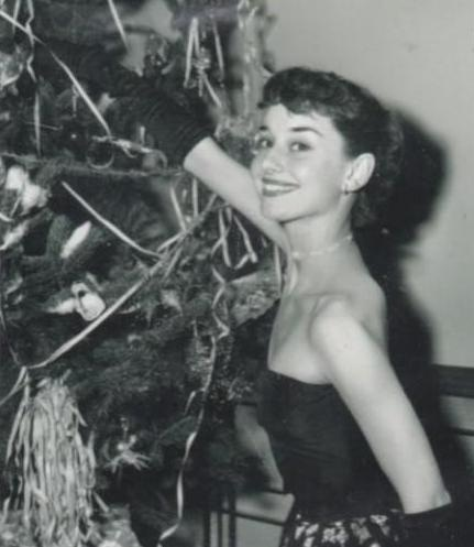 Audrey Hepburn decorating the tree