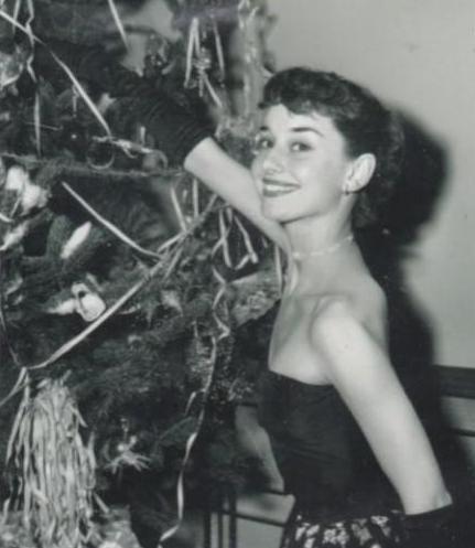 Audrey Hepburn decorating the tree