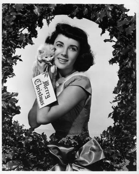 Elizabeth Taylor and kitten in wreath