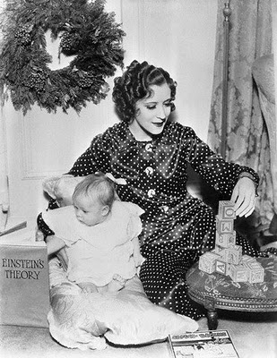 gracie allen with child by tree