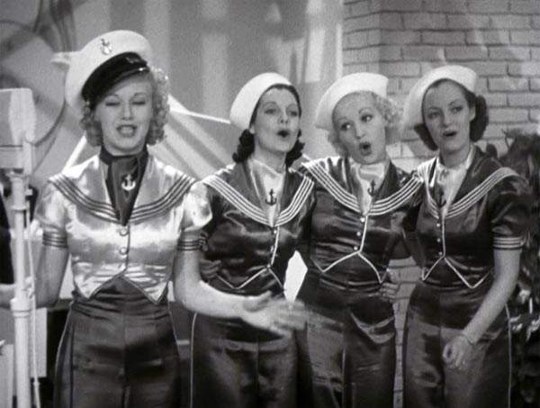 Ginger Rogers sings Let Yourself Go in Follow the Fleet, Betty Grable in background