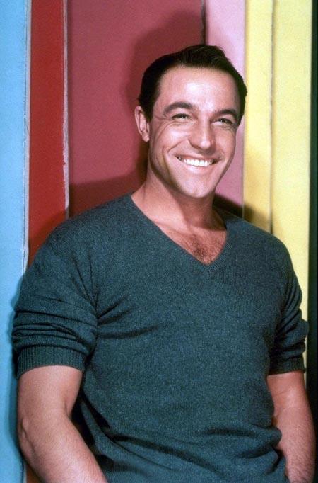Gene Kelly, flashing his famous smile