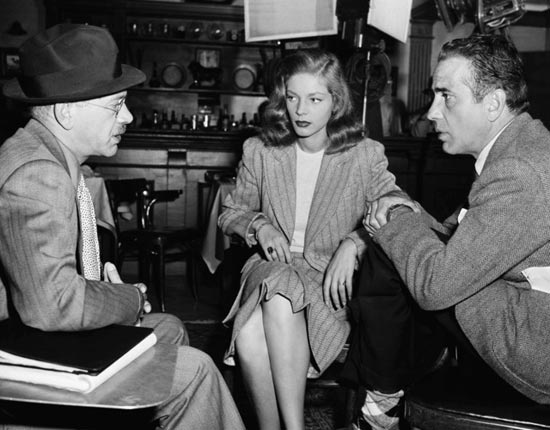 Humphrey Bogart and Lauren Bacall between-the-scenes with director Herman Shumlin on the set of Confidential Agent