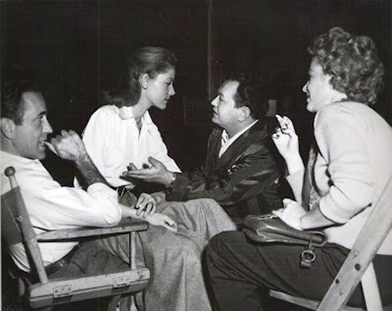 Humphrey Bogart, Lauren Bacall, Edward G. Robinson and Claire Trevor on the set of Key Largo