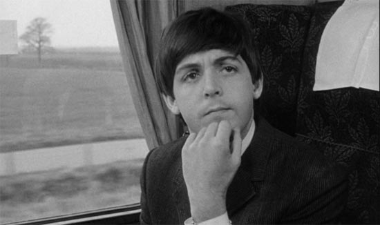 A Hard Day's Night, Paul McCartney feigns interest, on train
