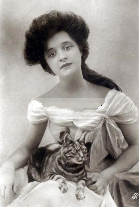 a young Billie with a cat on her lap, circa 1906