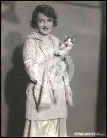 Billie in the 1920s with a tabby cat