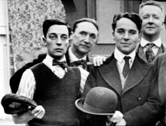 Charlie Chaplin and Buster Keaton posing for photo