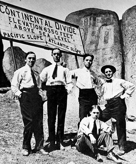 Charlie Chaplin and Stan Laurel (to Chaplin's left) stand on the Continental Divide in Butte, Montana while touring America with Fred Karno, 1911