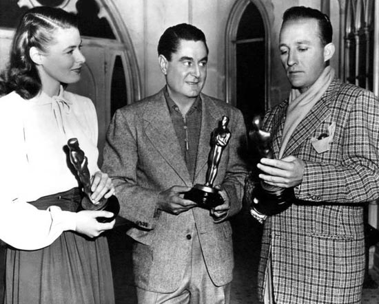 At the 1945 Oscars, Leo McCarey (Best Director) and Bing Crosby (Best Actor) win for Going My Way, while Ingrid Bergman wins for Gaslight (Best Actress).  McCarey's next film, The Bells of St. Mary's (1945) would feature both Crosby and Bergman