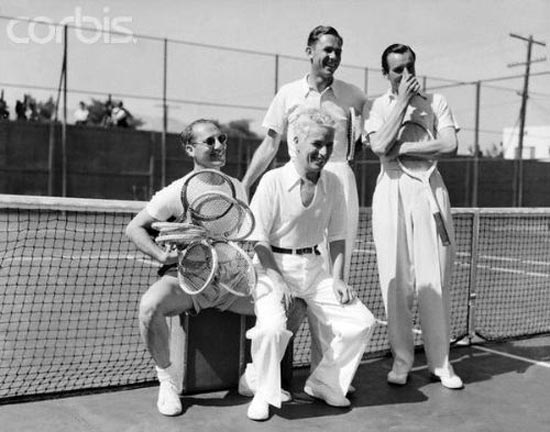 Groucho Marx and Charlie Chaplin in 1937 game of tennis at opening of Beverly Hills Tennis Club, with players Ellsworth Vines and Fred Perry