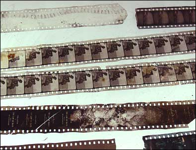 In the days of silent film theaters, projectors occasionally malfunctioned and damaged the film prints being shown. When such incidents occurred, the projectionist would splice the film back together and go on with the show, discarding the damaged film. These bits and pieces of original silent film--apparently victims of projector malfunctions--were found by workers when the projection booth was restored. Photo: HPO collection.